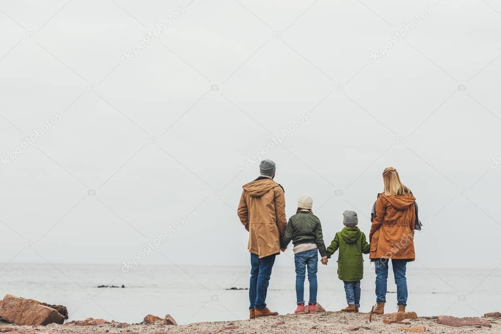 family looking at sea