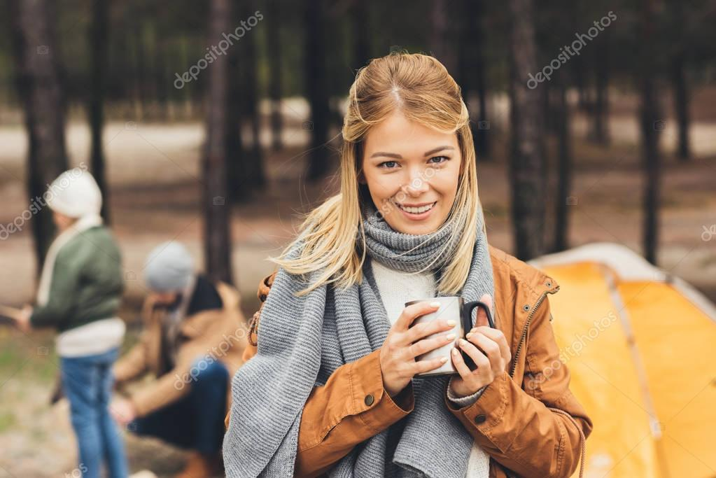 woman with mug of hot drink outdoors