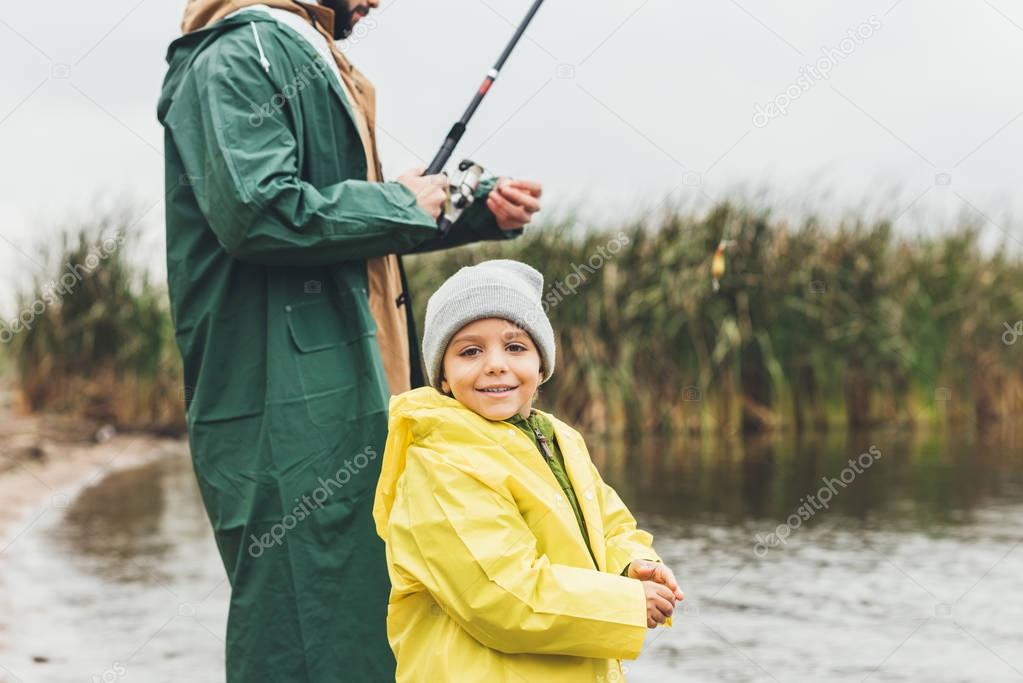 son fishing with father