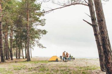 family having picnic on nature