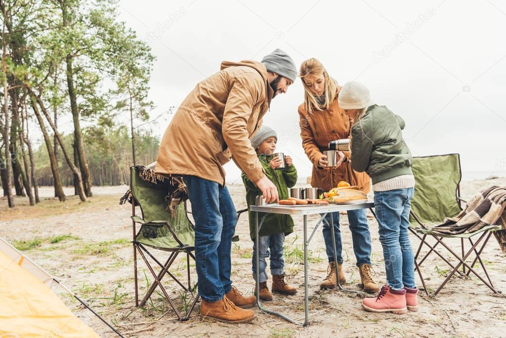 family having picnic on nature