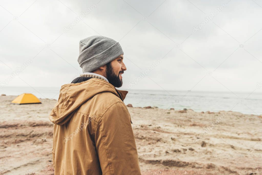 young man standing on coast