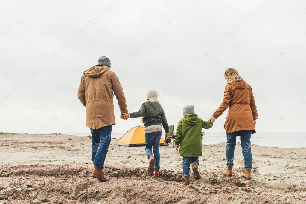 family walking to camping tent