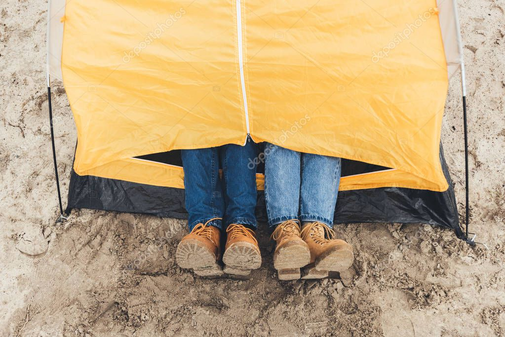 couple laying in camping tent