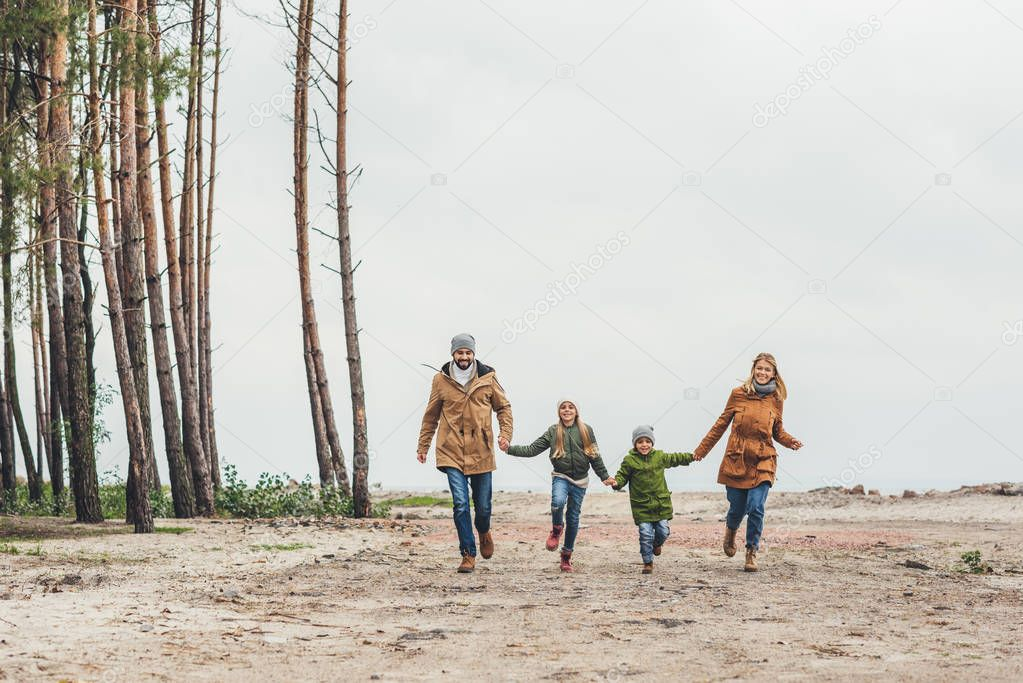 family running and holding hands