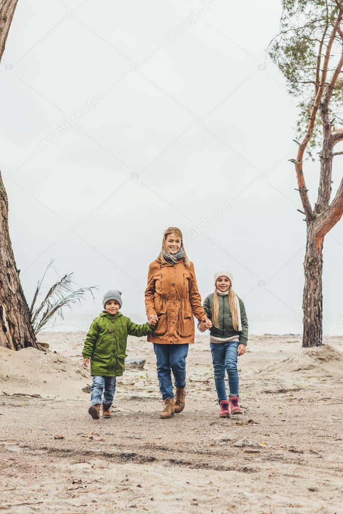 mother and kids walking outdoors