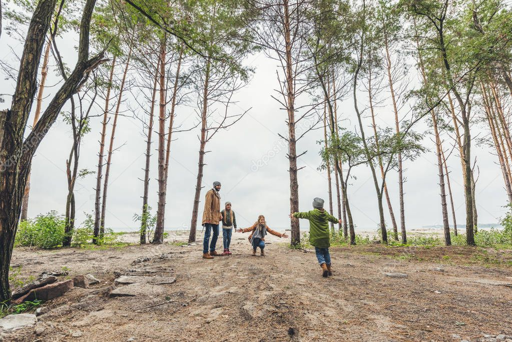 family spending time together on nature