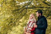 couple drinking coffee in park