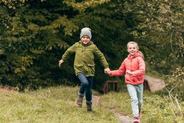 children running in autumn park