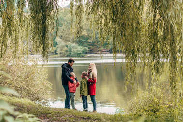 family near lake