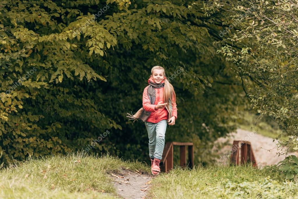 child running in autumn park