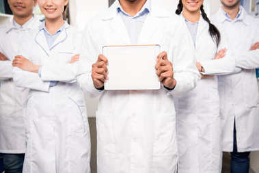 Team of doctors with blank card