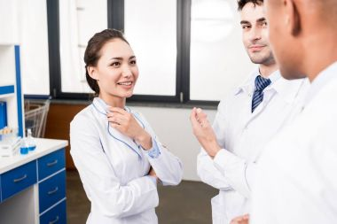 doctors discussing work in laboratory