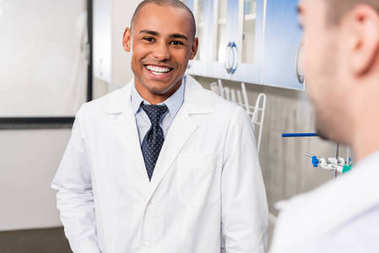 african american doctor in lab coat