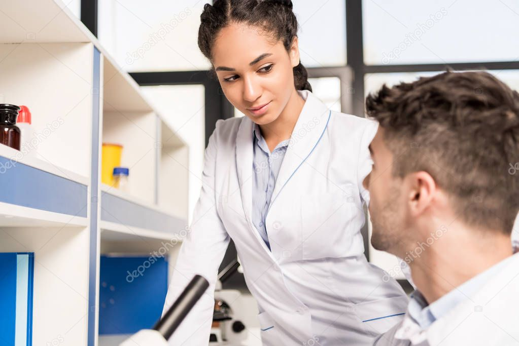 Lab technicians discussing work
