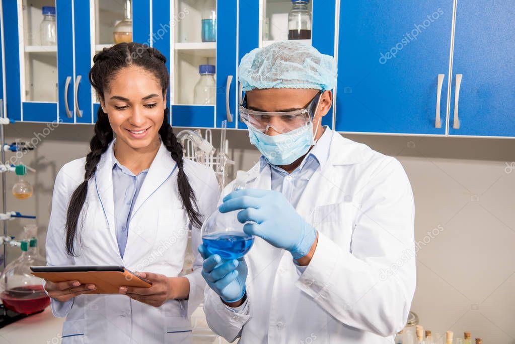 Scientists analyzing test tube