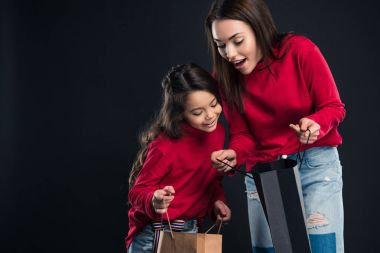 Daughter and mother looking into shopping bags