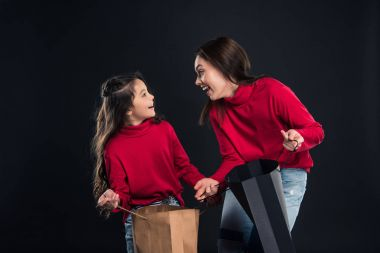 mother and daughter with open shopping bags