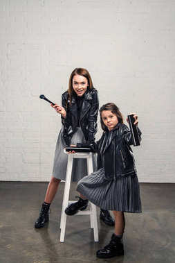 Mother and daughter with makeup brush