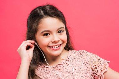 kid putting earphones into ears