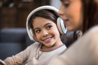 smiling daughter in headphones