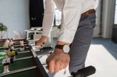 Fotografie cropped shot of businessman playing table football at office