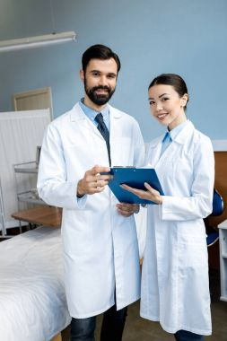 doctors holding diagnosis