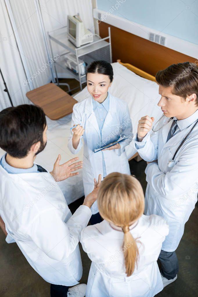 doctors team discussing diagnosis