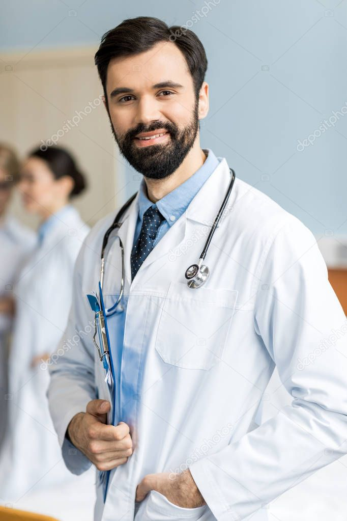 smiling doctor in clinic