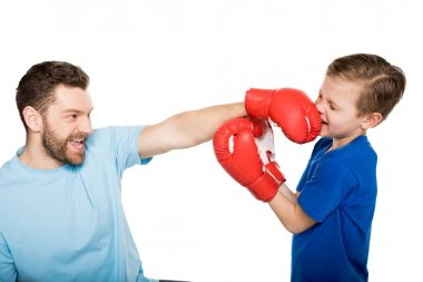 Father with son boxing together