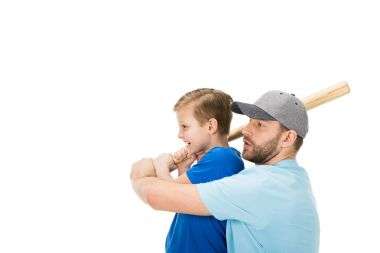 Side view of father teaching his son how to play baseball isolated on white stock vector