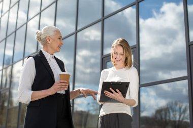 businesswomen on meeting outdoors