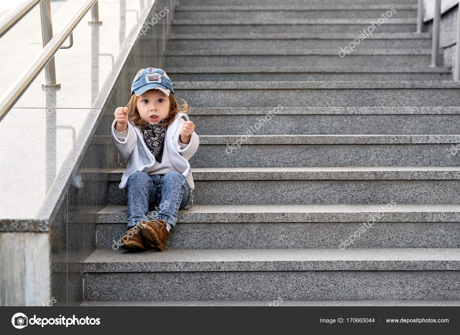 c5bc8bf6c model child hip-hop sitting on stairs outdoor.girl child street ...
