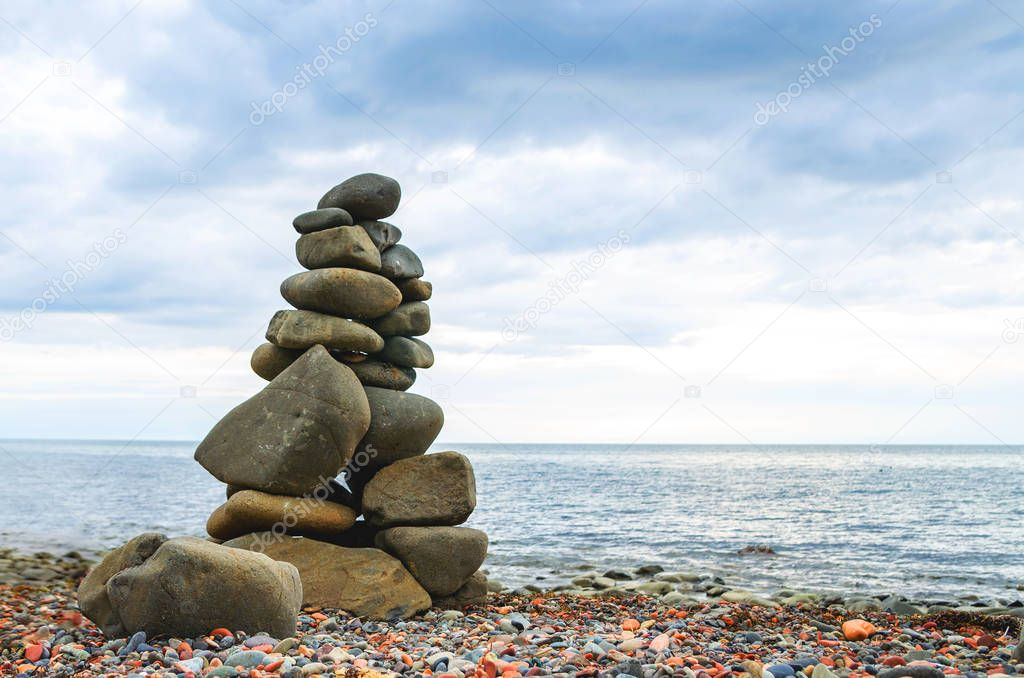 Tower of the stones on the beach.
