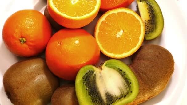 orange and kiwi fruits