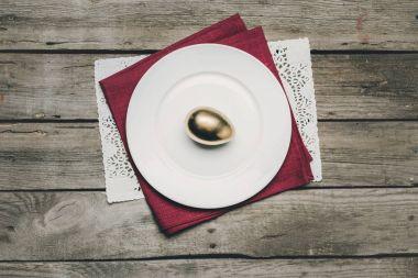 Golden Easter egg on plate