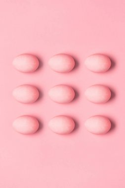 rows of painted pink eggs