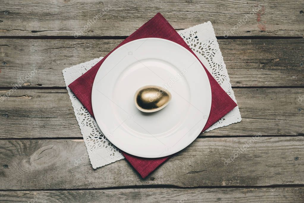 Golden Easter egg on plate