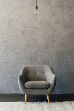 Grey armchair in empty room