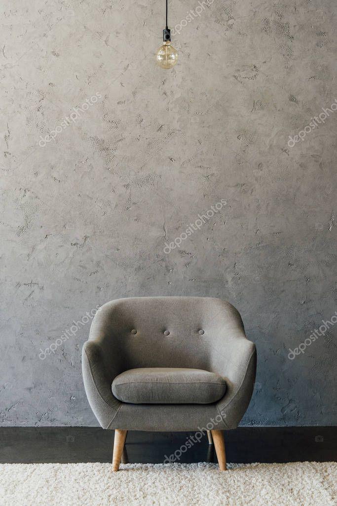 Grey armchair in empty room