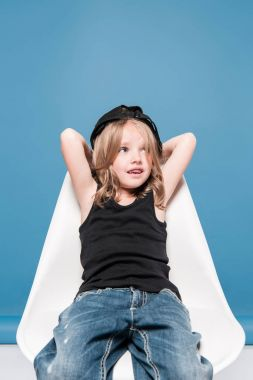 casual kid girl sitting on chair