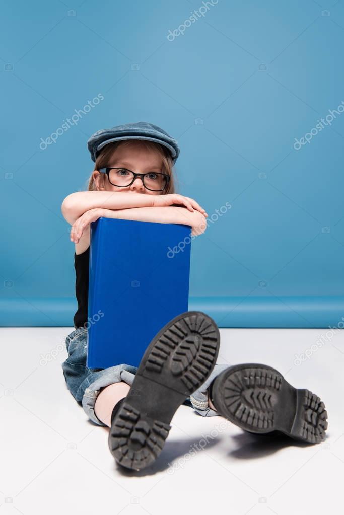kid girl holding book