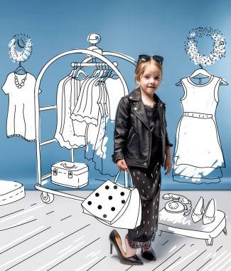 Stylish girl choosing clothes