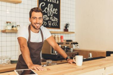 Portrait of smiling barista leaning on counter in coffee shop stock vector