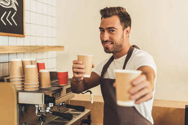 barista showing coffee to go