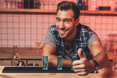 Barman showing thumb up at counter