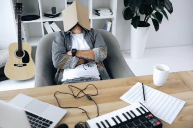 Sound producer sleeping with magazine on face at workplace stock vector