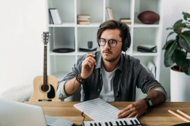 musician thinking about new composition