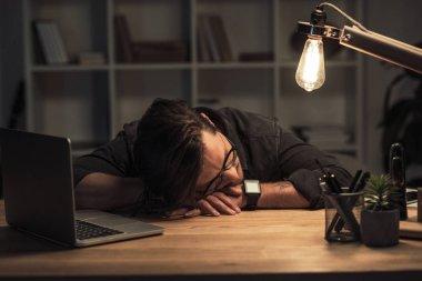 businessman sleeping at workplace