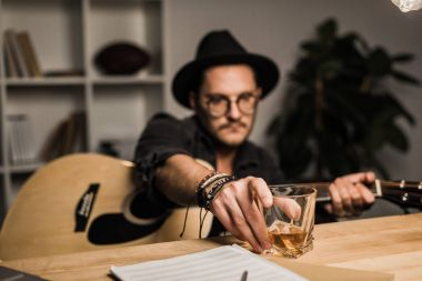unsuccessful musician drinking alone